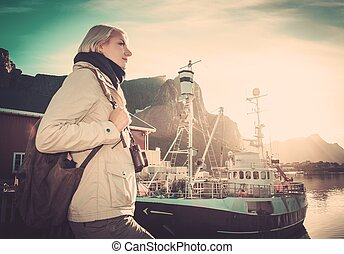 Woman traveler in Reine village, Norway