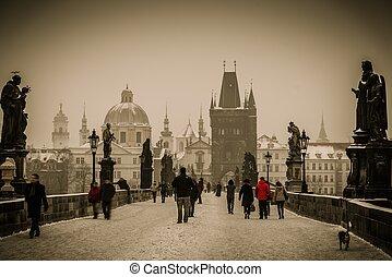 People walking on a Charles bridge in Prague