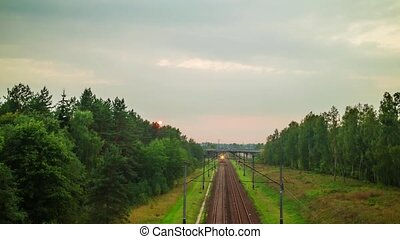 Railway in the forest, hyper time-lapse