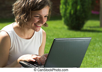 Communicating via internet - Smiling student is...