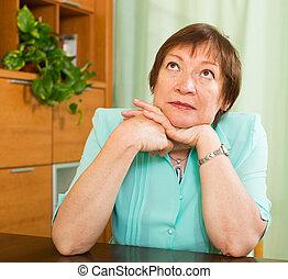 Thoughtful mature woman