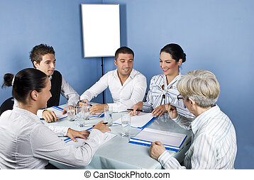 Business people around a table at meeting - Five business...