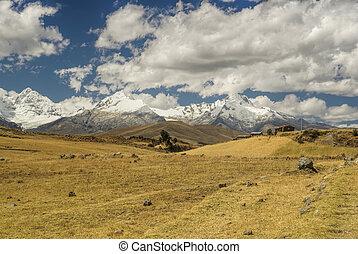 Cordillera Negra in Peru - Clouds passing over sunlit...