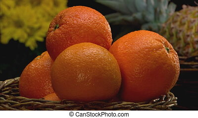 Orange CU - CU of a wicker basket filled with navel oranges...