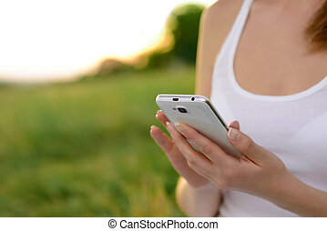 Woman Using Mobile Smart Phone Outdoors - Woman Using her...