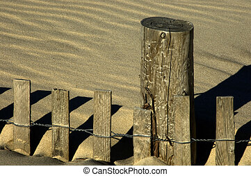 Sand and Fence - Dunes are an act of nature. Fences are an...