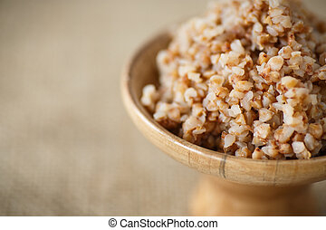 boiled buckwheat - Boiled buckwheat in a wooden bowl on a...