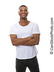 Portrait of a friendly young man smiling with arms crossed