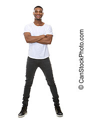 Full length portrait of a cool young guy smiling with arms...