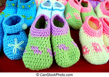closeup of crocheted baby shoes on the market