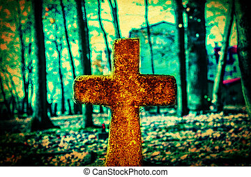Cross - Old and forgotten cross gravestone in dark mystical...
