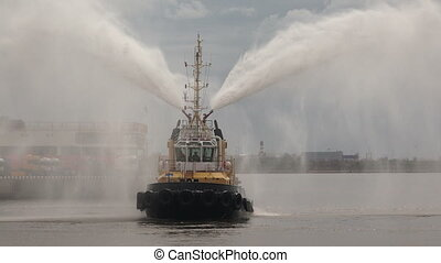 Fire boat. Hose. Shot in 4K (ultra-high definition (UHD)),...
