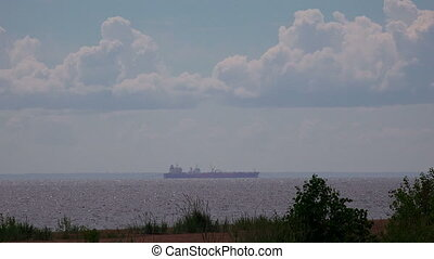 Barge on the horizon. Gulf of Finland. Shot in 4K...