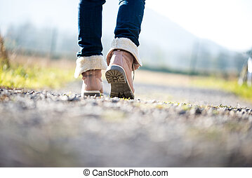 Woman walking along a rural path - Low angle ground level...