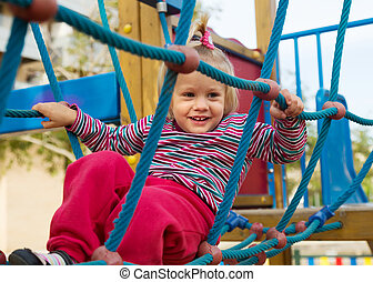 Excited girl developing dexterity at playground - Excited...