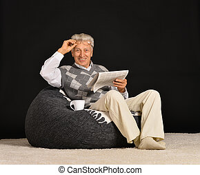 man reading newspaper - Elderly man reading newspaper...