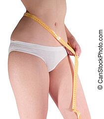 Woman measuring waist with a tape measure