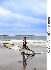 lone Atlantic way windsurfer getting ready to surf - lone...