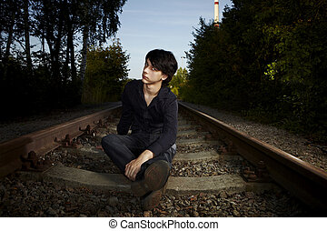 I am waiting for a train - Moody young man acting his...