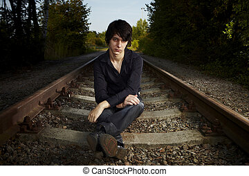 Where is the train - Moody young man acting his emotions and...