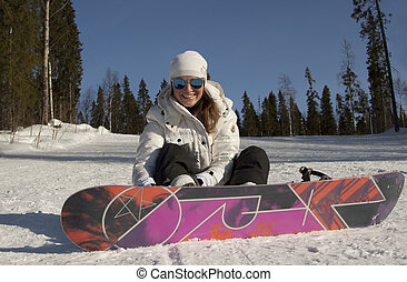 Beautiful Young Woman Snowboarder Smiling on Snowy Mountain