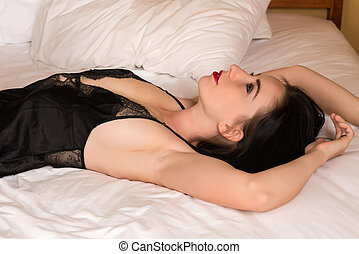 Black negligee - Pretty young brunette in a black negligee
