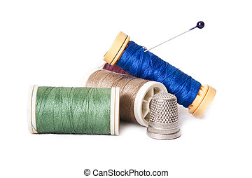 stitching yarns - sewing threads isolated on the white...