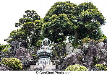 A Buddha Overlooks the Temple Grounds - A bhudda statue...