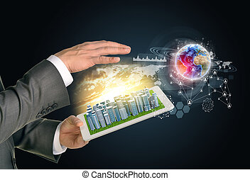 Man hands using tablet pc. Business city on touch screen. Earth with network near computer