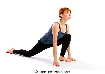 Woman Practising Yoga Exercise - Young fit woman doing yoga...