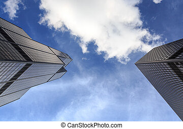 Chicago Towers - View straight up at blue skies and...