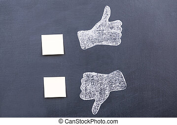 Yes or no? Blackboard drawing of thumbs up and down with...