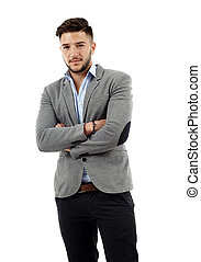 Young businessman with arms folded