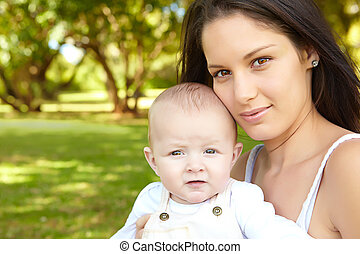woman with her baby son in the park