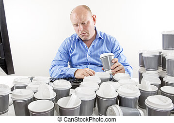 Overworked businessman drinking too much coffee - Exhausted...