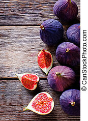 figs on a dark wood background tinting selective focus on...