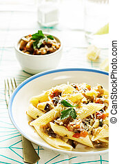 pasta with eggplants on a light background tinting selective...