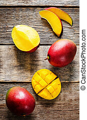 mango on a dark wood background tinting selective focus on...