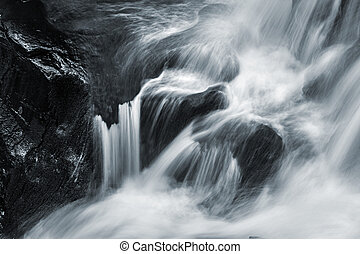water cascade - Waterfall and forest stream in the...