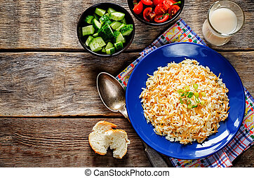 Rice with vermicelli on a dark wood background. Traditional...