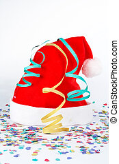 Christmas hat with ribbons and confetti on white background
