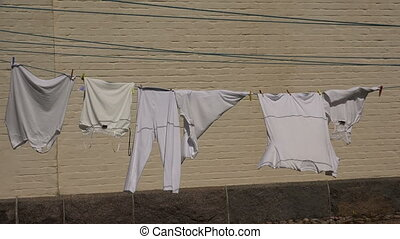 White linen drying on the rope Shot in 4K ultra-high...