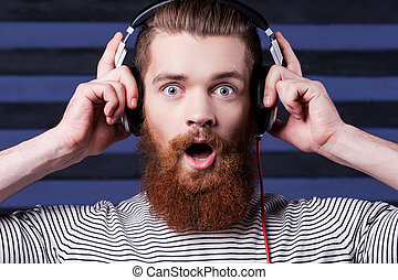 It is amazing song. Confident young bearded man in...