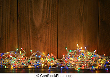 Christmas lights on wooden background. Selective focus
