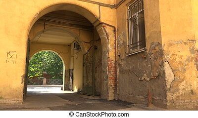 Old courtyard with arch in St. Petersburg. Shot in 4K...