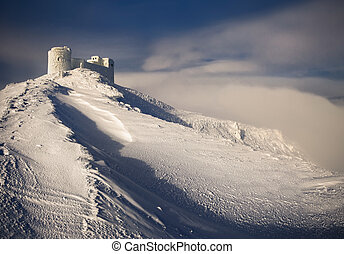 Ancient fortress in the; mountains in the winter