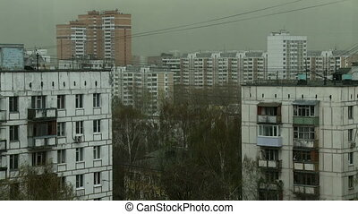 View of apartment buildings on overcast day - Windy weather...