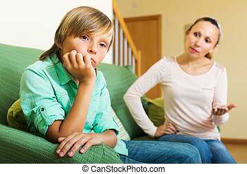 Mother berating teenager son - Mother scolding teenager son...