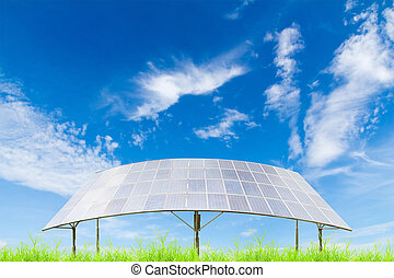 Solar panels on green grass field against blue sky...