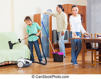 Family cleaning with vacuum cleaner - Happy family of three...